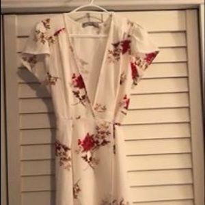 White floral low cut wrap dress